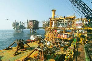 ONGC's oil drilling platforms at Bombay High. Global demand for rigs has already raised exploration costs and India has among the largest number of outstanding drilling commitments in the world.