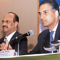 Road ahead:A file photo of GVK Industries chairman G.V. Krishna Reddy (left) with vice-president Sanjay Reddy. The proposed LNG terminal may become part of the Dahej port, said Krishna Reddy.