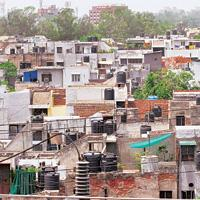 Housing concerns: Delhi Development Authority houses in Janakpuri, New Delhi. The agency acquires land for the development of New Delhi and builds low-income houses.