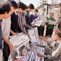 Mass media: File picture of people at a news-stand in Srinagar. The Indian Readership Survey is a biannual readership survey that is used by newspapers and magazines to assess their relative competiti
