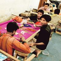 Protection call: A file photo of children at a garment unit in Shahpur Jat. Activists say children rescued after the Gap scandal need to be properly rehabilitated, or else most of them will be back at
