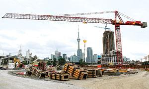 Infrastructure upgrade: A construction crane on the site of a condominium being built in Toronto. Demand for some of the world's biggest construction cranes is coming from countries such as India that