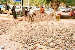 Civic work on a New Delhi road. Most municipal bodies are in no shape to fund even small portions of development projects