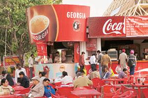 A Georgia stall in New Delhi. Coffee drinking has increased in metros as well as in tier II cities.