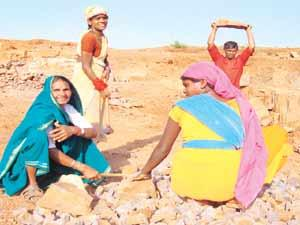 Helping themselves:Bhiranwan Bai Verma (left, blue saree) and other members of the Kohoka Gaon District Rajnandgaon Women self-help group, which has secured a mining lease, at work in their stone quar