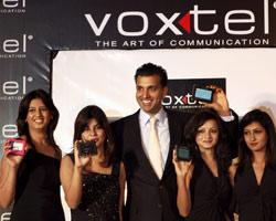 Dino Lalvani, CEO of Voxtel Telecom, with models during the launch of  GPS Personal Navigation Devices and VoIP Phones in New Delhi