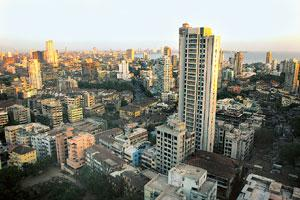 Precious property: The Mumbai skyline. Developers who built townships based on the old law are expected to take a hit on profits, as exemptions were granted on condition that they develop basic infras