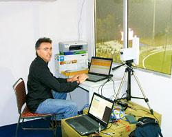 GPSports Systems managing director Adrian Faccioni analyzing data picked up by tracking antenna in a glass-fronted cabin at the Panchkula stadium near Chandigarh