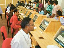 Traders participate in electronic auction of cardamom that was launched on Saturday at Vandanmedu in Kerala