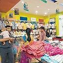 Stock taking: People shopping at a store in New Delhi. According to the report coordinated by the World Bank, India's share of the world economy based on PPP dropped to 4.3% from a previous estimate o