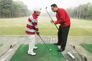 Game theory: Singh demonstrates the correct swing to his student Meheraj Chadha at the Delhi Golf Club.