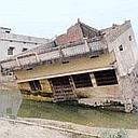 Hard reality: A flash flood in August destroyed many houses in Basahi, Bihar, and left 22 people dead.
