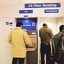 Extra charges: A Deutsche Bank ATM in New Delhi. Currently, some banks charge as much as Rs57 for one transaction when customers use the ATMs of other banks for cash withdrawals and balance enquiry.