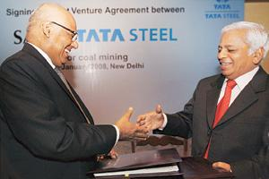 Etched in steel: Tata Steel MD B. Muthuraman (right) and SAIL chairman S.K. Roongta exchange documents after signing the agreement for a joint venture firm to mine coal in India on Thursday.