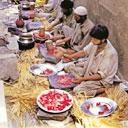 Workers preparing the meat for a wedding feast in Kashmir. (IndiaPicture)