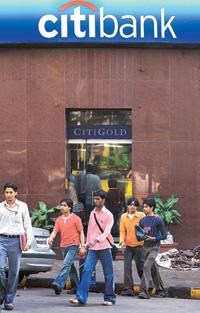Right direction: People walk past a branch of Citibank in Mumbai.