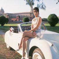 With the Rashtrapati Bhavan as  backdrop, fashion designer Malini Ramani poses sitting on an imported convertible.