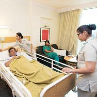 At home: Nurses tend to a patient at a New Delhi hospital. Patients can now order for home nurses at Fortis pharmacy stores in the capital. (Photo: Madhu Kapparath/ Mint)