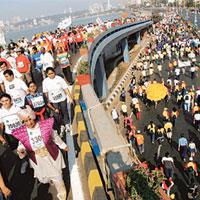On the move: Participants run the fifth edition of the Mumbai Marathon on Sunday.