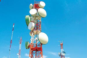 Being tested: A file picture of telecom towers. The new technology, claims its developer, can do away with the need for different radio infrastructure for CDMA, GSM phone networks. It's being tested i