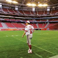 Gearing up: A New York Giants player taking a walk at the University of Phoenix Stadium, Arizona, ahead of Sunday's Super Bowl XLII.