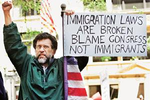 Unfair treatment? A 2006 file picture of an immigrant from Mexico during a rally in Boston, Massachusetts, as part of 'A Day Without Immigrants' protest. More than 12 million people are living illegal