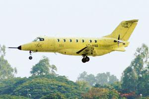 Under development: A May 2004 photo of the first prototype of India's first indigenous civilian aircraft, Saras, as it undertakes its maiden flight in Bangalore.