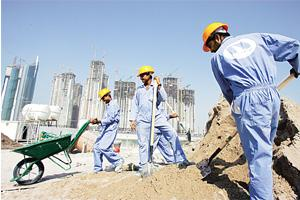 Paid well? Asian workers prepare concrete at a construction site in Dubai. According to the Indian embassy, there are about 270,000 Indians in Bahrain of whom 70% are semi-skilled or unskilled workers