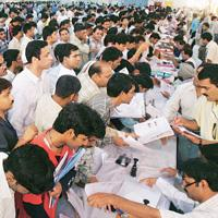 Pain reliever: A file photo of people rushing to file income-tax returns at a temporary office set up at Pragati Maidan in New Delhi. It will be easier for taxpayers if post offices and banks could ac