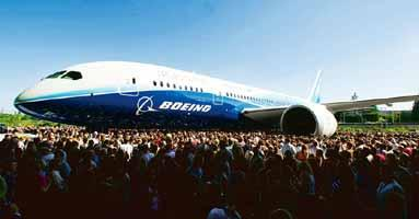 Getting bigger: A file picture of spectators at the launch of Boeing's 787 Dreamliner jet in Everett, Washington. Chennai-based Paramount Airways is considering to buy seven such planes. (Kevin P. Cas