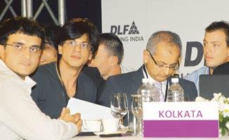 New ball game: Former Indian cricket captain Sourav Ganguly (left) with IPL team owner Shah Rukh Khan (second from left) during the auction of cricket players in Mumbai on 20 February. (AP)