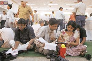 Taxing times: Assessees at a special income-tax filing facility at Pragati Maidan in New Delhi on 29 July 2007.