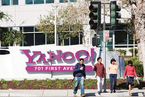Downward trend: Pedestrians cross a street outside Yahoo Inc.'s headquarters in Sunnyvale, California. Notwithstanding Microsoft's $44.6 billion takeover bid for Yahoo or Electronic Arts' $2 billion o
