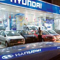 Immediate response: A Hyundai showroom in New Delhi. The company cut the prices of its small cars by as much as Rs19,000. Small cars, which account for about 75% of the total number of cars sold in th