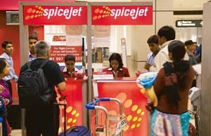 Worker-oriented: Airline firm Spicejet's employees attend to travellers at the Delhi airport. Companies across sectors such as aviation, real estate, banking and financial services plan to offer Esops