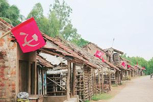 Landlocked: A deserted stretch of road near Ranichowk village, 10km west of Nandigram. Last November, many villagers had to flee their homes as warring groups of Communist Party of India (M) cadre and