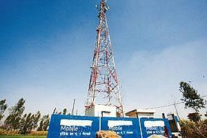 Rapid development: A telecom tower in Muzaffarnagar, Uttar Pradesh. There are around 125,000 phone towers in the country, a number that is expanding fast and putting pressure on frequency available. (