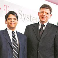 IT partners: Francisco D'Souza (left), CEO of Cognizant, with Reinhard Clemens, CEO of T-Systems, at the CeBIT fair in Hannover, Germany.