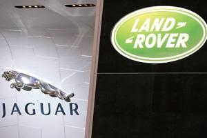 Overseas pitch: A view of the Jaguar and Land Rover brand logos at the Geneva Motor Show. A successful acquisition of the UK car brands is expected to help the Tata group expand its overseas reach.