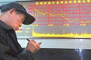 Reverse trend: A man takes notes in front of an electronic board showing stock information at a brokerage in Shanghai. China's main stock index lost more than 2% on Wednesday.