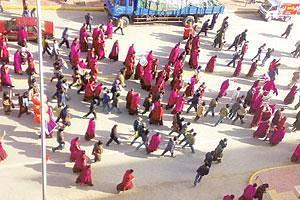 Trouble spot: Monks and protesters rally in Amdo Labrang, north-eastern Tibet, on Saturday. Residents of the remote city high in the Himalayas said anti-riot troops controlled the streets and were clo