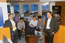 IBM's Anil Menon (left), CLI founder and director Sujit Kumar (centre), flanked by two of his team members, and Innovation Centre for Partners manager Vithal Madyalkar (right)
