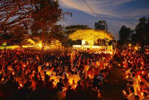 Praying for peace: Tibetans hold candles during a prayer march in Bylakuppe, Karnataka, on Wednesday.  (Hemant Mishra / Mint )