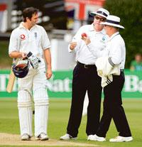 Umpires confer during a 13 March Test match between England and New Zealand in Wellington, New Zealand. Kingfisher's branding of umpires will include its logo on their shirts and hats