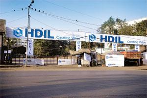 Maximizing value: HDIL billboards at what was earlier a used-car lot at Andheri in Mumbai.