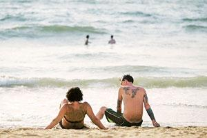 Cool comfort: Tourists sunbathe on Calangute Beach in Goa. Airlines is India are offering ready-made, complete holiday packages to international tourists to generate a separate revenue stream.