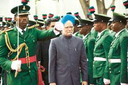 India's Prime Minister Manmohan Singh reviews a guard of honour during his visit to the Nigerian presidential villa in Abuja last October