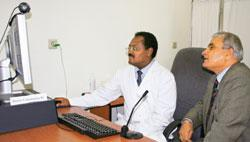 Asfaw Atnafu (left) uses a high-speed Internet connection to communicate with doctors at Care Hospital in Hyderabad