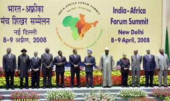 Prime Minister Manmohan Singh and African Union Chairman Prof Alpha Oumarkonare (white cap) pose for a group photo with other dignitaries at the inaugural session of India-Africa Forum Summit 2008, in