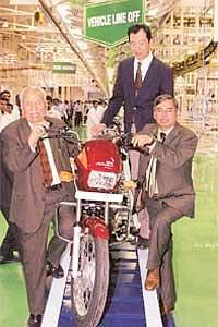 Riding high: Hero Honda executive chairman Brijmohan Lall Munjal (left), managing director Pawan Munjal (right), and chief operating officer (Asia and Oceania) Fumihiko Ike at the Haridwar plant.